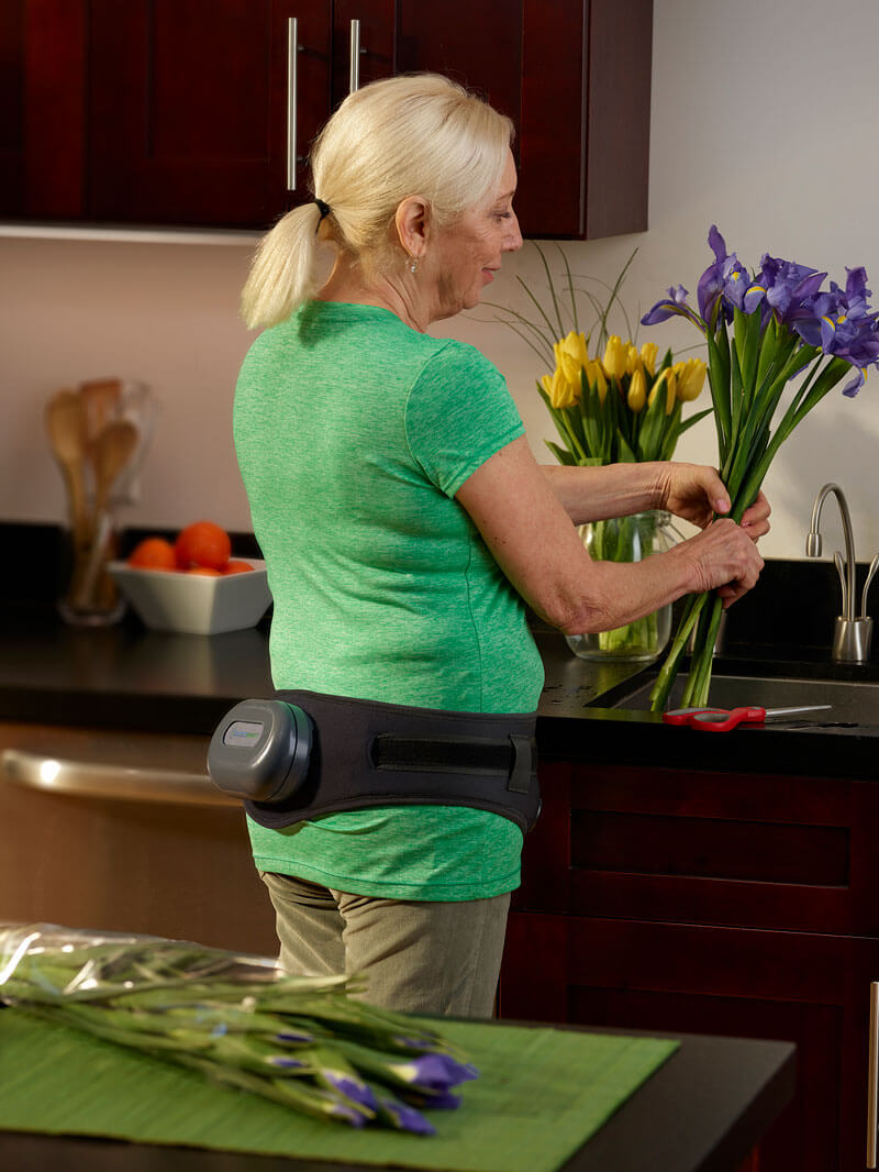 osteoboost on woman cutting flowers
