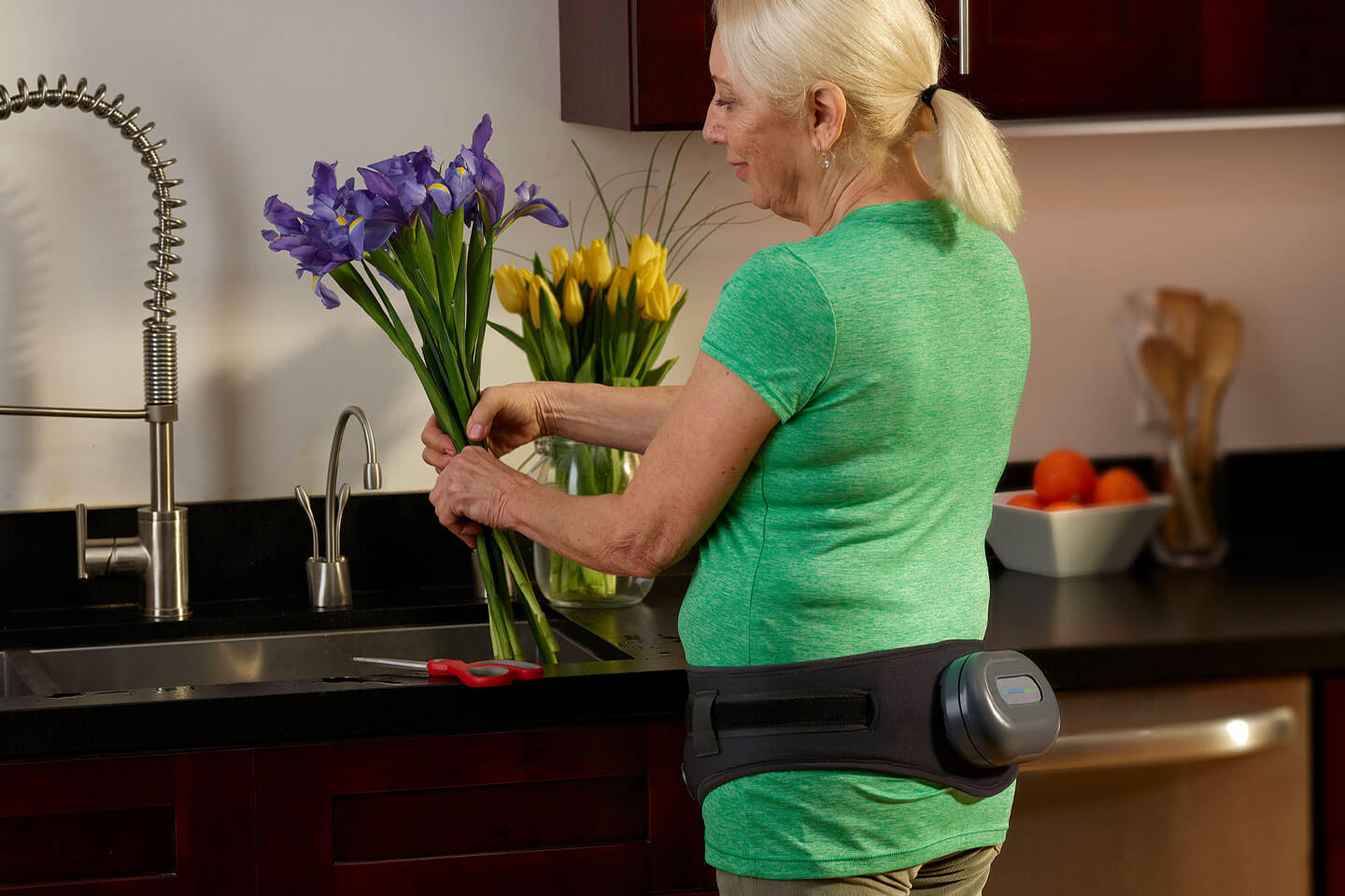woman with osteoboost in kitchen